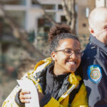 officer and student posing for photo